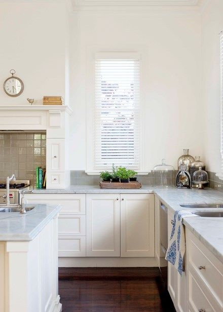 In the kitchen, a Bianco Gioia marble-topped island bench acts as an informal eating area, prep zone and storage unit | Home Beautiful Magazine Australia