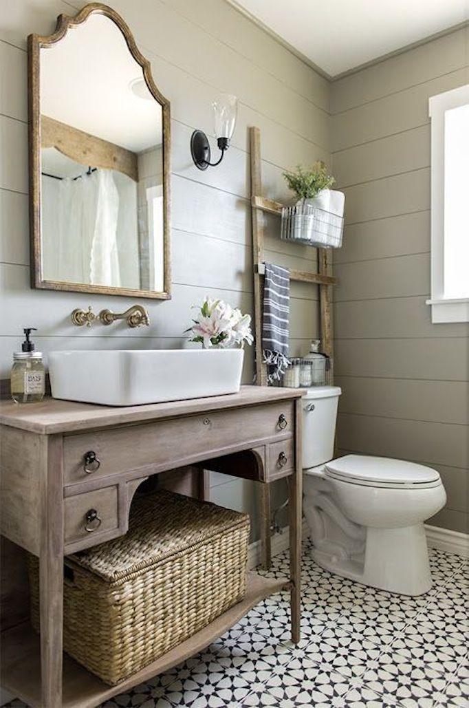 BECKI OWENS--Colors of the Modern Farmhouse + Paint Guide. Beautiful Greige Farmhouse bathroom with shiplap, black and white cement tile, Valspar Gray Silt.