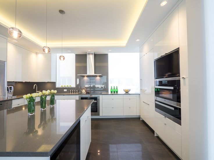 The ceiling details in this bright apartment kitchen