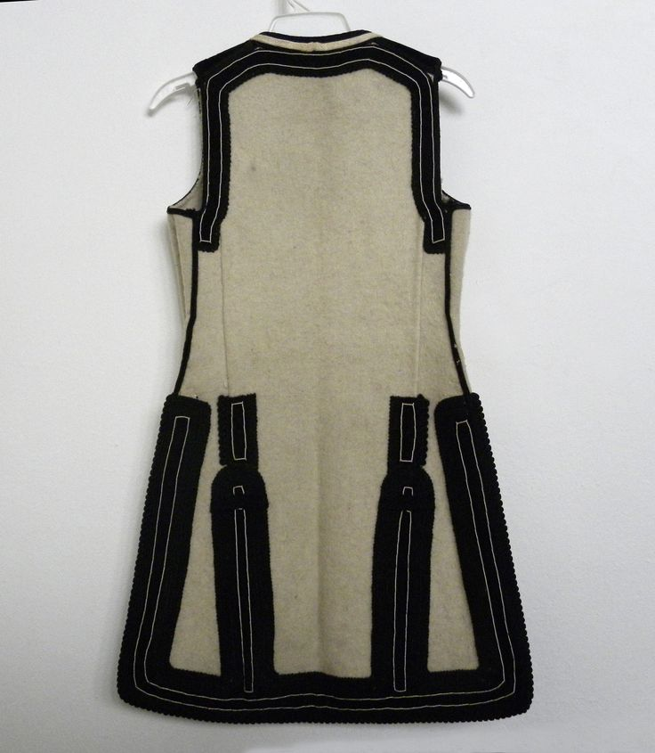 Shajak - vest (upper no sleeves white part) also embroidered with black thread,  made from 100% woven wool