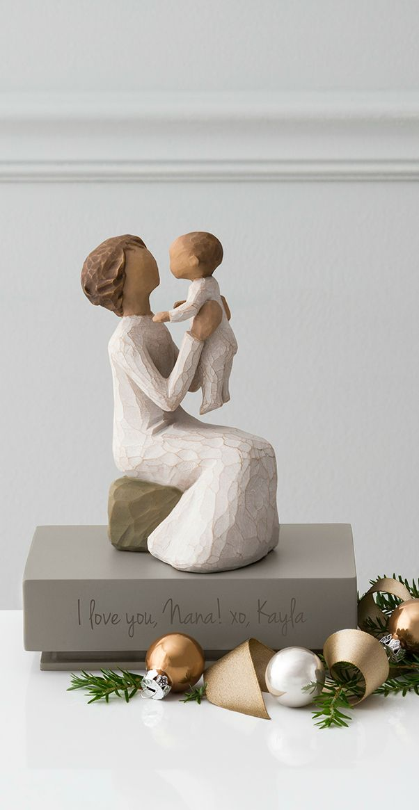 The exclusively personalized Willow Tree Grandmother Figurine depicts a caring grandmother with a little one with a separate, engravable shelf for display. Pick up a Willow Tree figure perfect for a birthday present or Mother's Day gift!