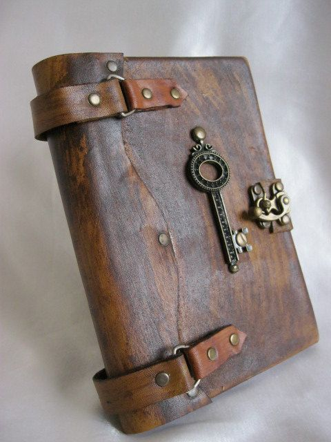 Luxury handmade vintage look blank leather journal notebook with a decorative key emblem. $62.99, via Etsy.