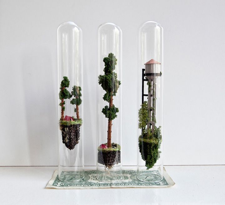 Dutch artistRosa de Jongconstructs worlds inside slender glass test tubes—each complete with micro-sized buildings, teeny tiny trees, and other structures inhabitable by nothing larger than an ant.