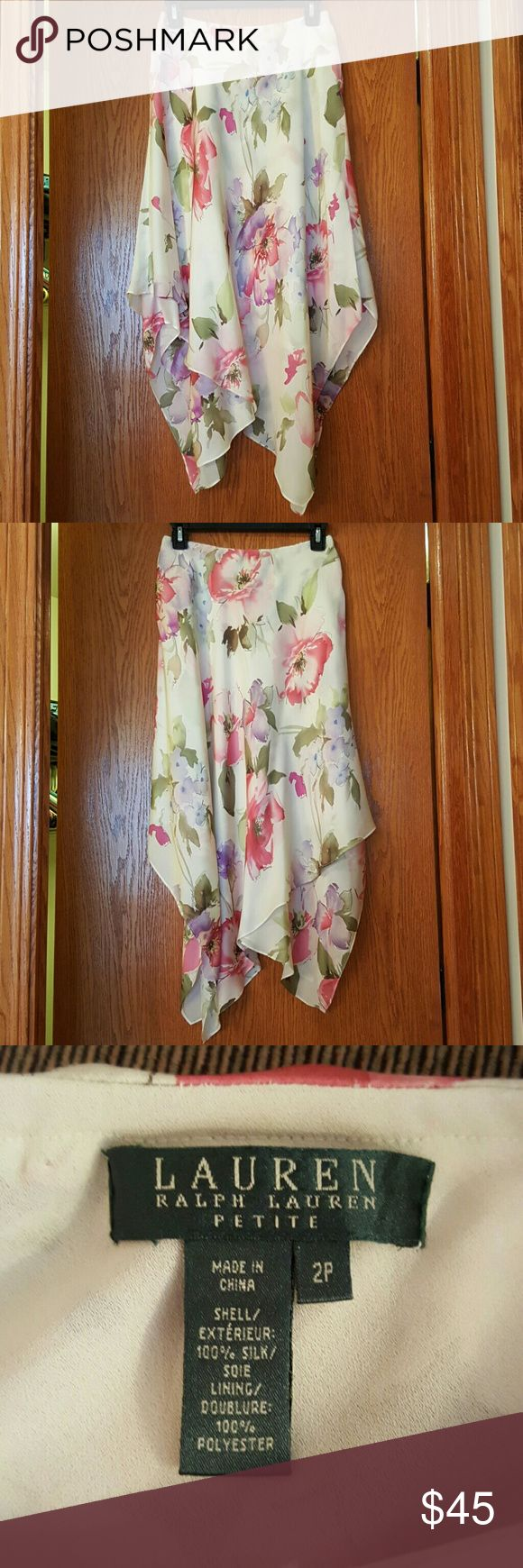 Stunning Watercolor Handkerchief Silk Skirt Ralph Lauren 100% silk long flowing skirt. Beautiful floral water color. Built in slip. Does have a few very small snags that are not noticeable. Has always been dry cleaned. Also selling top that was usually worn with it... Lauren Ralph Lauren Skirts Asymmetrical