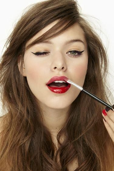 Red lips, winged eye.  A sexy date night look.