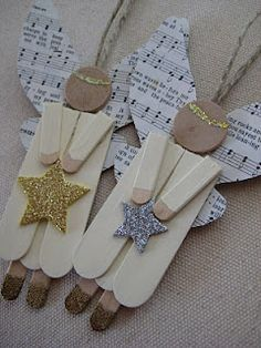 Popsicle stick angels. LOVE this!!!! We will be making this this year...I may even have this for Sam's class...maybe bring two ornament options for them to choose from in case the boys dont' want to do this!