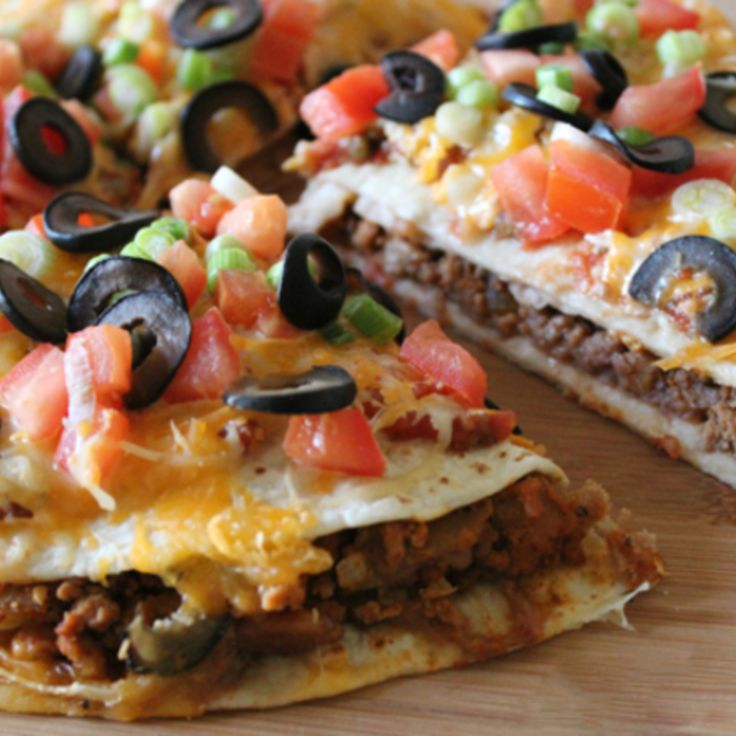 Mexican Pizza Recipe Yield: 2 Mexican Pizzas Prep time: 20 min | Cook time: 25 min | Just A Pinch Recipes