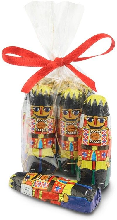 Nutcracker chocolate tree decorations by Chocolate Trading Co. made from high quality milk chocolate.   Add a touch of festive, British pageantry to a Christmas tree with these delicious edible decorations. A gold cord is attached for hanging.  Available in different quantities from a small gift wrapped bag to a bulk priced box containing 120 individually foiled chocolate Nutcracker Soldier tree decorations, without gift packaging, at trade cost.  Each Nutcracker soldier measuring 6cm tall.