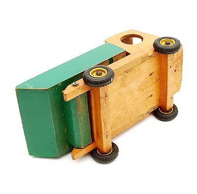 Botterweg Auctions Amsterdam > Wooden toy truck with green and yellow painted container, with original metal wheels with rubber tires, design Ko Verzuu ca.1935, executed by ADO(Arbeid Door Onvolwaardigen), Berg en Bosch / the Netherlands