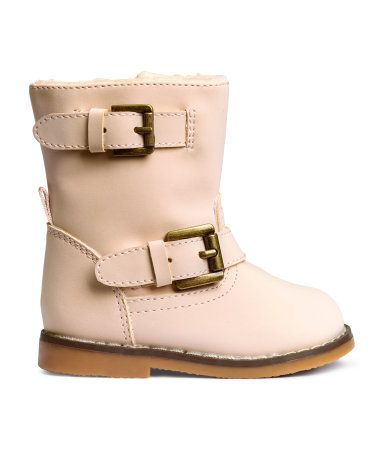 Biker boots in imitation suede. Decorative tabs with metal buckles, zip and Velcro fastener at side, and pile lining. Rubber soles.
