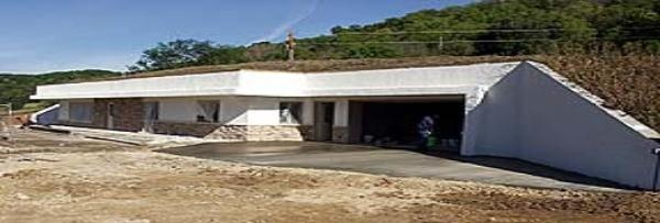 A retaining wall style underground home with multiple facings - under construction