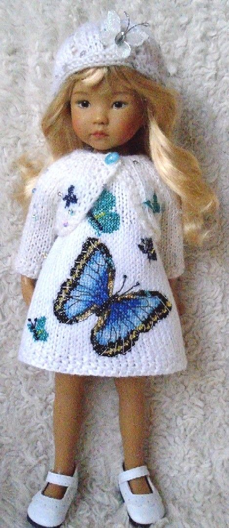 counted cross stitch on knitted dress