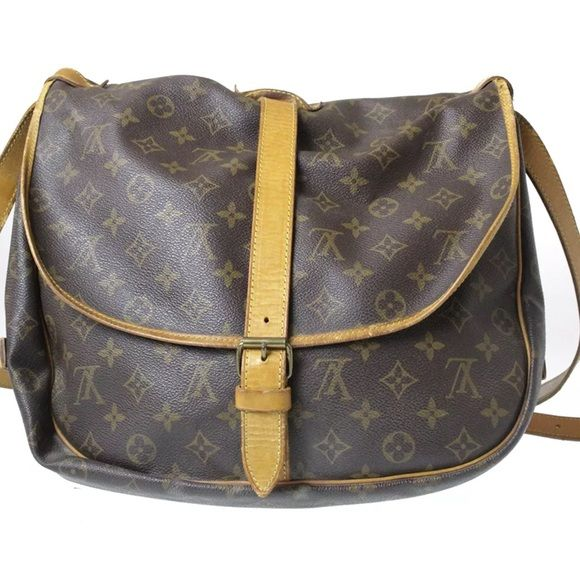 Louis Vuitton Saumur 35 Mono Canvas Cross Body Beautiful roomy 35 SAUMUR cross/shoulder bag. MADE IN FRANCE. Shoulder strap drop 22 inches. This bag has been previously owned, visible signs of: dirt, creases, dirt, cracks, (cracks on straps), odor, discoloration, rips, over all this bag is gorgeous and any of the above mentioned can be very minor but needs to be mentioned for you to be aware, just incase photos are not clear enough.  NO TRADES !!!!   No LOWBALLING !!!! Thank you  Louis…
