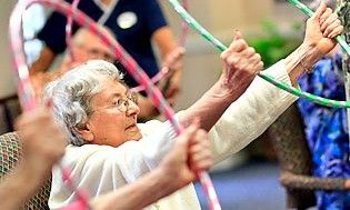 elderly women exercising with hoops