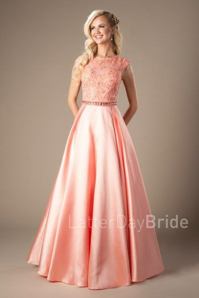 Modest Prom Dress 2017 | LatterDayBride & Prom | SLC | Utah | Worldwide Shipping | Afton | This modest prom gown features a high neckline, soft lace bodice, dazzling natural waistband and a satin pleated skirt. In Coral