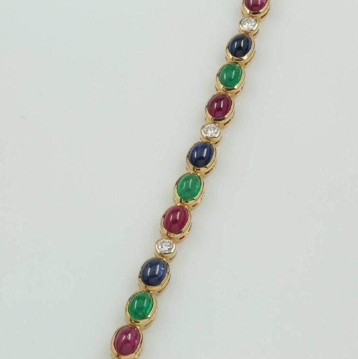 Armband mit Rubinen, Saphiren, Smaragden und Brillanten, GG 750/000, Farbsteincabochons zus. ca. 20.58 ct, 6 Brill. zus. ca. 0.90 ct feines Weiß/vvs, Kastenschließe m. Sicherung, L. 18 cm Schätzpreis: 13300,- EUR  5360,- €