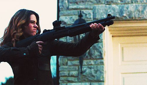"""Nikita, season 2, episode 20, """"Shadow Walker,"""" aired on 27 April 2012. Alexandra """"Alex"""" Udinov is played by Lyndsy Fonseca. Alex is firing a Benelli Nova NFA Tactical 12 Gauge shotgun with ghost ring sights, a dot sight, and collapsible stock."""