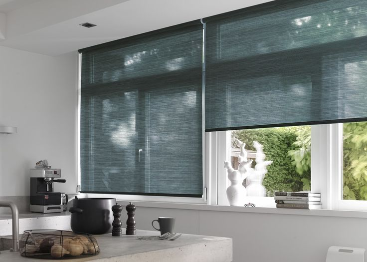 Monochrome kitchen with Luxaflex® sheer Roller Blinds. #Luxaflex #RollerBlinds