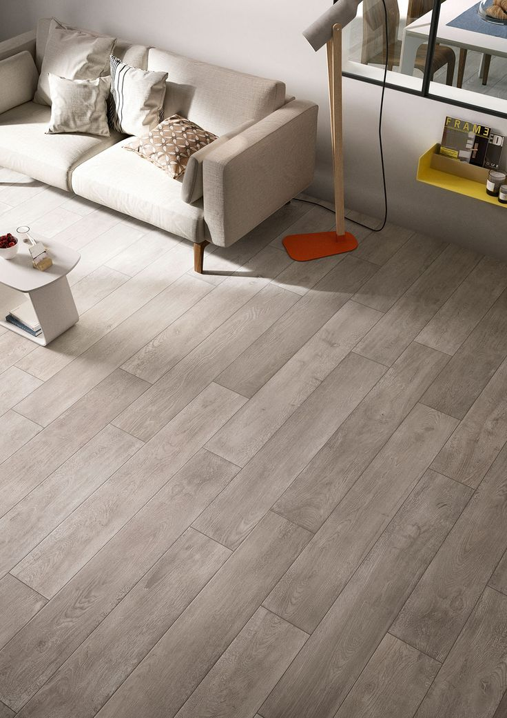 Wood floors throughout the house, except bedrooms and family room.  Treverktime - Wood effect stoneware floors