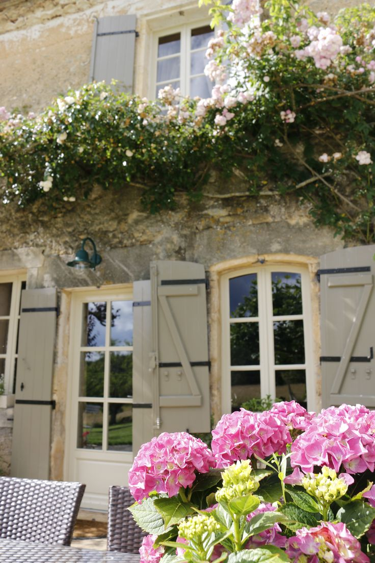 French country house style. Olive green shutters with sand-creme white windows, lots of roses and hortensias. Dordogne summer 2016