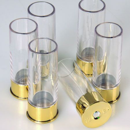 AWESOME!! Shot glasses that resemble shot gun shells. These come along with a belt that hold two fifths in its holsters.