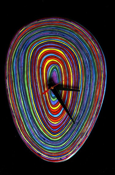 Wall clock with multicolored stripes by FantasyWare Clock - looks like it is Hundertwasser inspired!