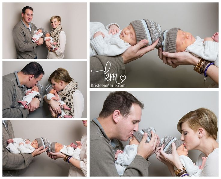Newborn twin boys with parents