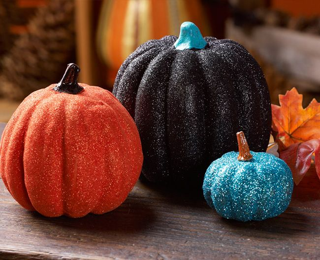 Not these colors but this idea-- Mod Podge and glitter are the perfect mix for glittering pumpkins!