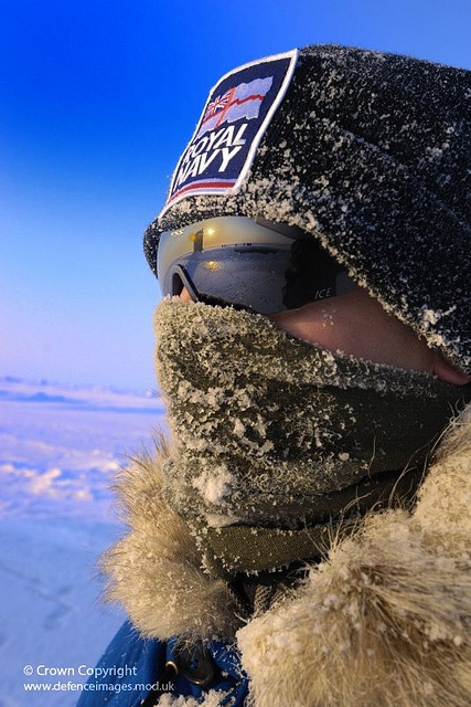 A Royal Marine Officer endures the Arctic weather and sub zero temperatures as he watches HMS Tireless surfacing in the North Polar region where she had conducted trials on equipment under the Arctic ice.