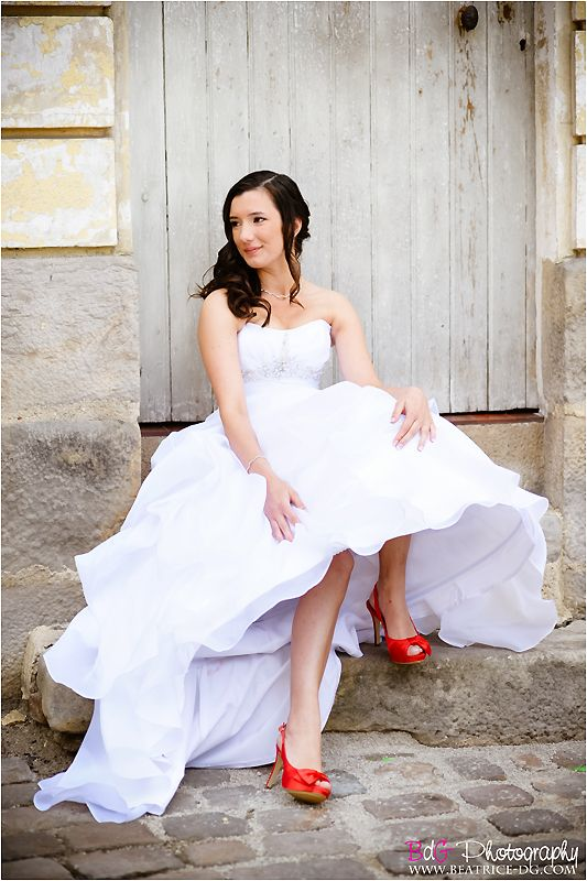 beautiful bride with red wedding shoes