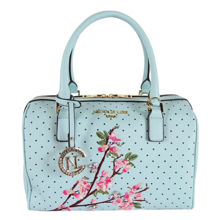 Tote your essentials in this lovely blue Boston handbag with a bright floral arrangement print. A double-handle style, authentic Nicole Lee logos and cute polka dots keep you stylishly organized. Hand