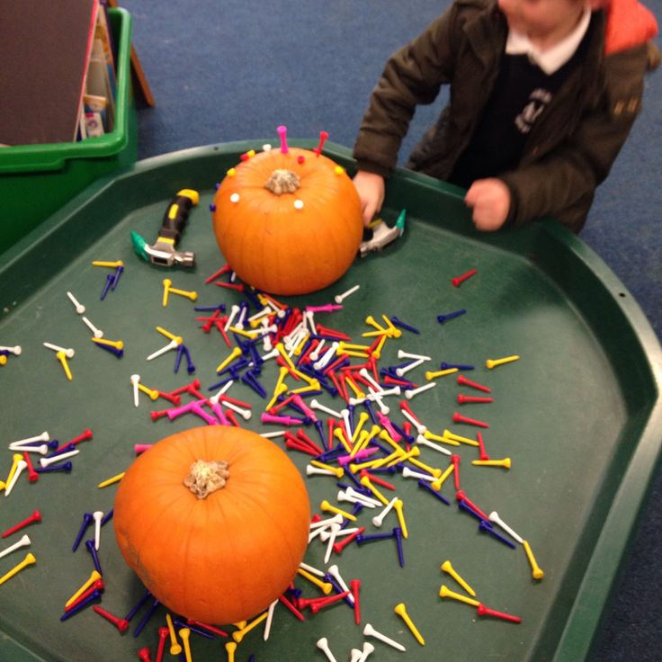 Creating/Following Patterns while developing fine motor: Golf tees pumpkins and hammers (eat pumpkins after - recipes are language patterns!)