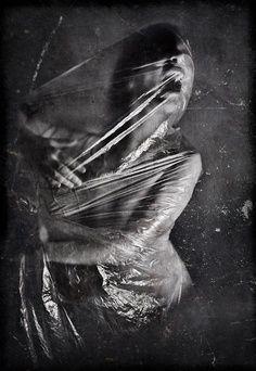 Dark Art. Model covered in plastic foil.