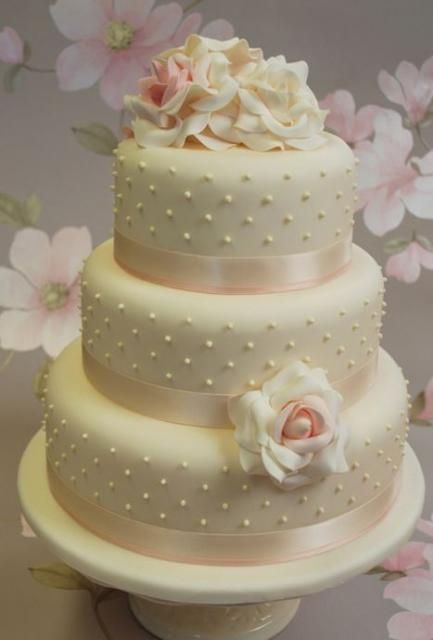 Round 3 tier ivory wedding cake with white roses.JPG