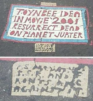 The Toynbee tiles (also called Toynbee plaques) are messages of unknown origin found embedded in asphalt of streets in about two dozen major cities in the United States and four South American capitals.[1][2] Since the 1980s, several hundred tiles have been discovered. They are generally about the size of an American license plate (roughly 30 cm by 15 cm), but sometimes considerably larger.