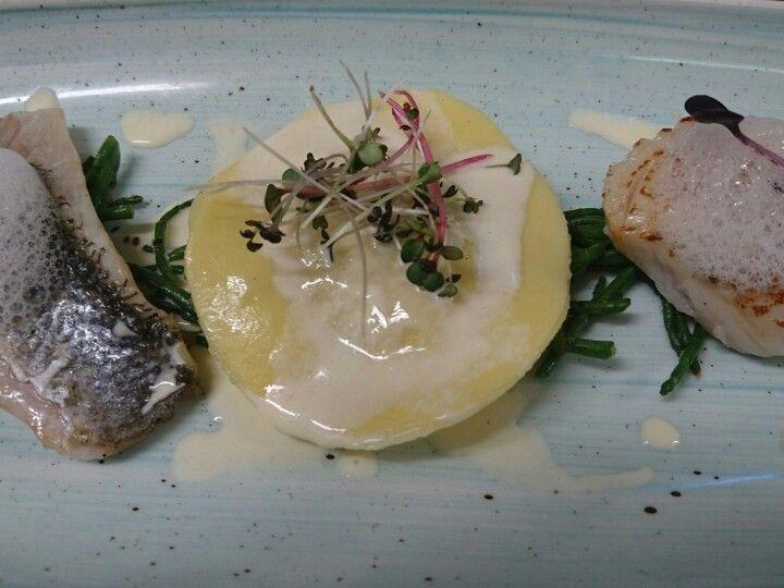 Crab ravioli, seared scallop, pan fried seabass, pernod cream.