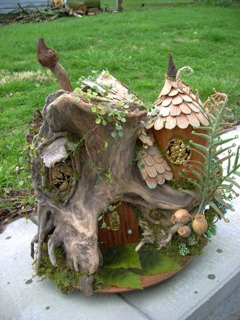 The natural character and texture of drift wood adds an ancient, twisted, otherworldly look to this unique fairy house. Great idea!