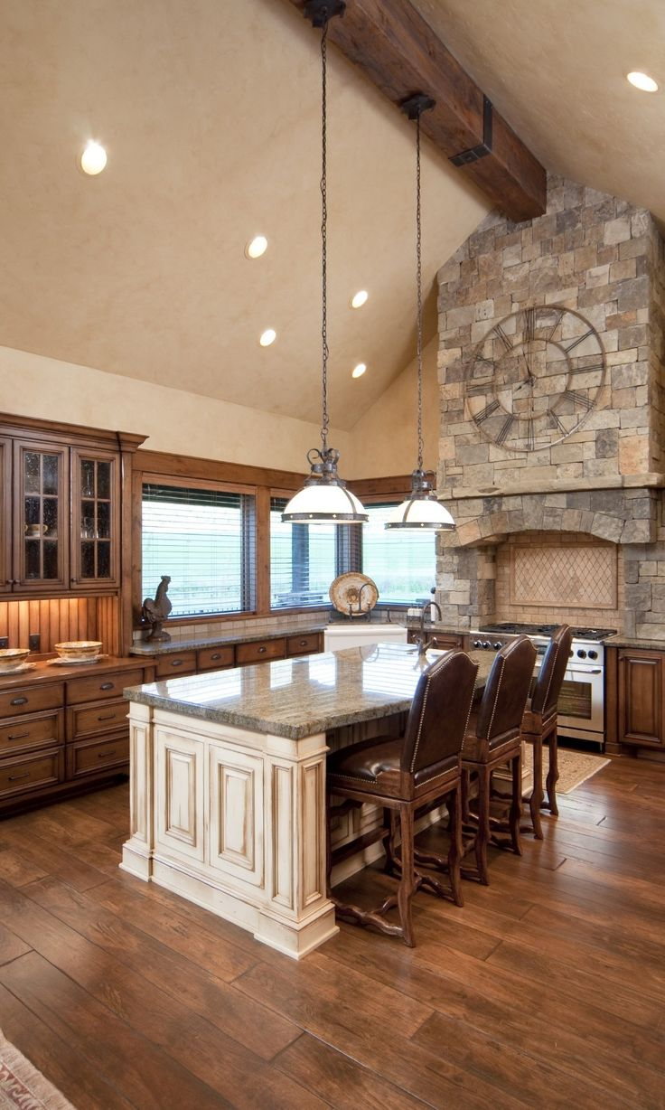 107 best future home images on pinterest dream house plans this kitchen is flush with warm natural wood tones natural stone wall above the range