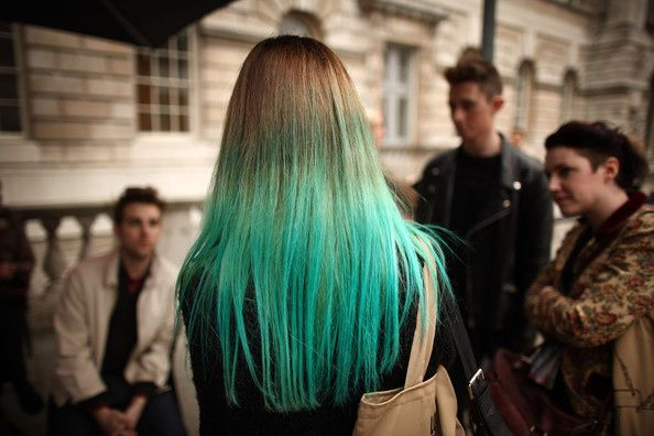 Use aspirin to turn hair made green by chlorine back to its natural color. Dissolve six to eight aspirin pills in a glass of warm water, coat hair with the solution, let is sit for 10 to 15 minutes, then rinse.