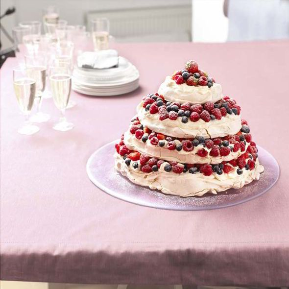Party Pavlova Pyramid ~ fresh berries & baked meringue layers | recipe from 'Cook Up a Feast' by Mary Berry and Lucy Young | via The Sunday Express