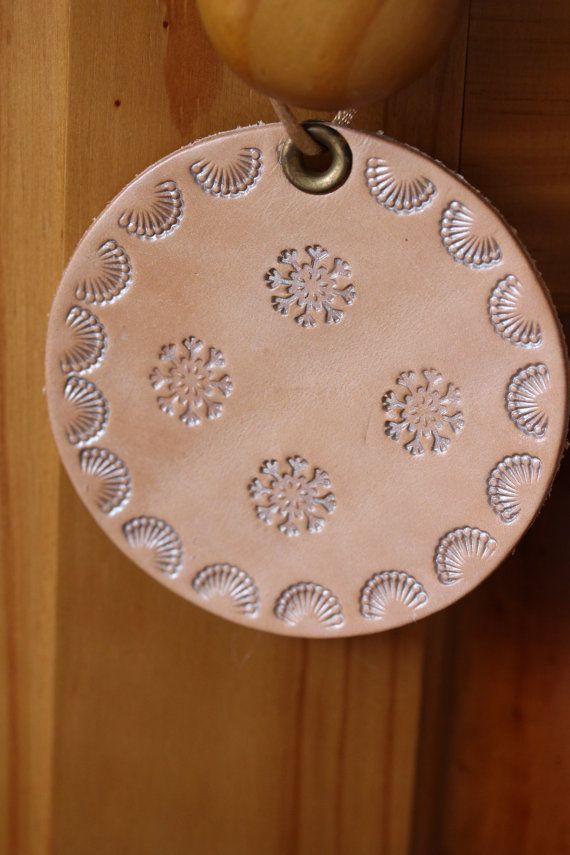 Snowflake Wall Hanging  Hand Tooled Leather by TinasLeatherCrafts. Repin To Remember.