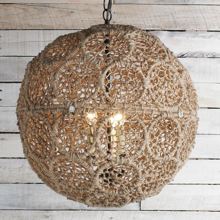 Large Macrame Jute Sphere Pendant  macrame of recycled metal and jute rope create this lovely large sphere pendant. The intricate pattern is well constructed and portrays a delicate lace design. This pendant is well suited for coastal chic to urban cottage interiors.