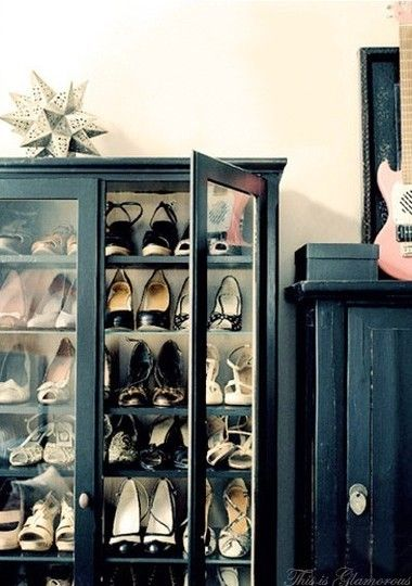 A glass display cabinet used to store designer shoes or handbags.  Would be a funtional and stylish touch to any walk-in closet.