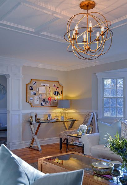 A Transitional Style Gold Light Fixture Illuminates The Living Room