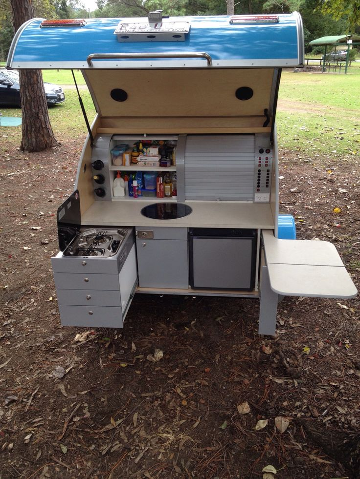 Riptide Teardrop kitchen with slide outs, roll top doors, fridge, round sink with lid, and even a built in wine rack!