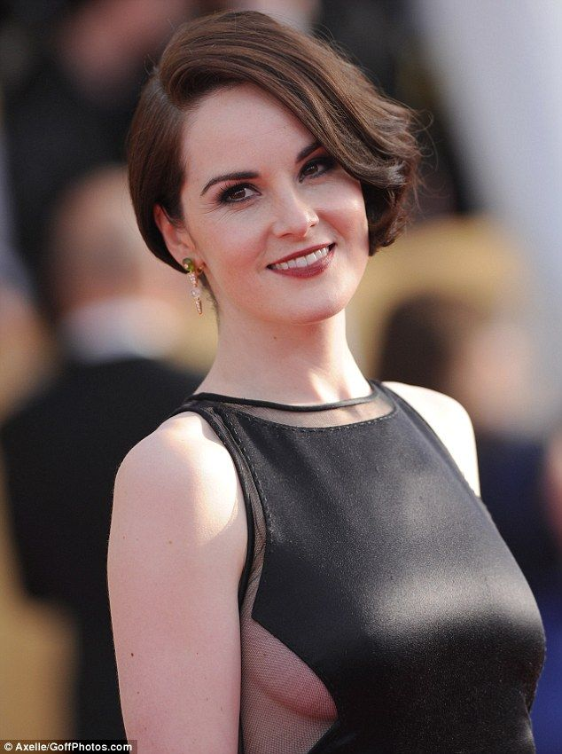 Michelle Dockery, English rose: The 31-year-old wore her brown hair in side parting swept to one side