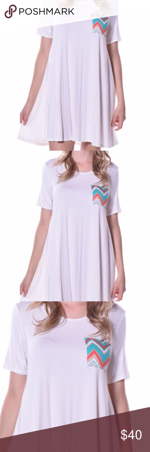 Chevron Pocket T-shirt dress Chevron pocket t-shirt dress. Perfect addition to your summer wardrobe. Lightweight material. 95% viscose 5% spandex. Made in the USA 🇺🇸 Dresses Midi