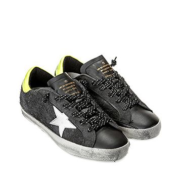 The Golden Goose certainly laid a golden egg with these shoes. A cool mix of street and grunge, these shoes are high quality, durable andwith a strike of neon yellow at the back just to let people behind you know what's up.  www.coolneonshoes.com  #shoe #skate