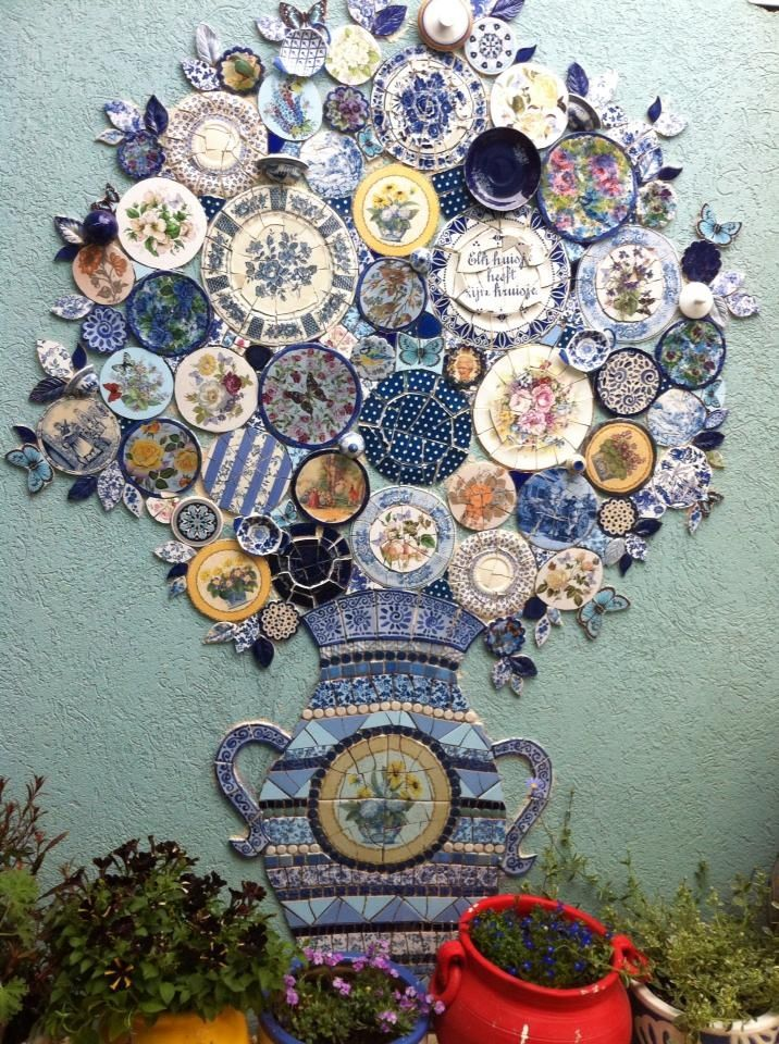 Blue and white..I thought this was pretty cool for a wall outside or inside with left over china you may have...