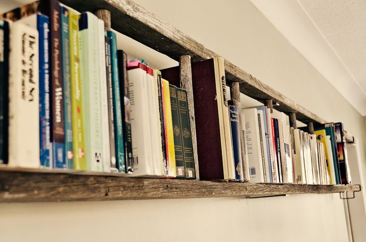 Old ladder bookshelf. Dan got a free ladder of craigslist just like this. What a good idea!